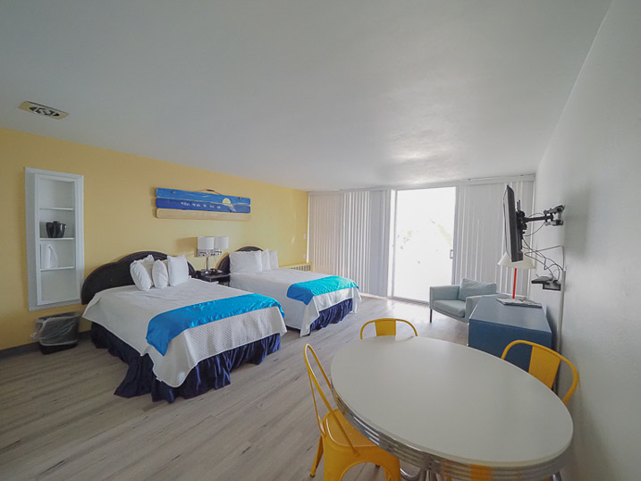 Our second floor room has a balcony overlooking the beach and two-double beds.