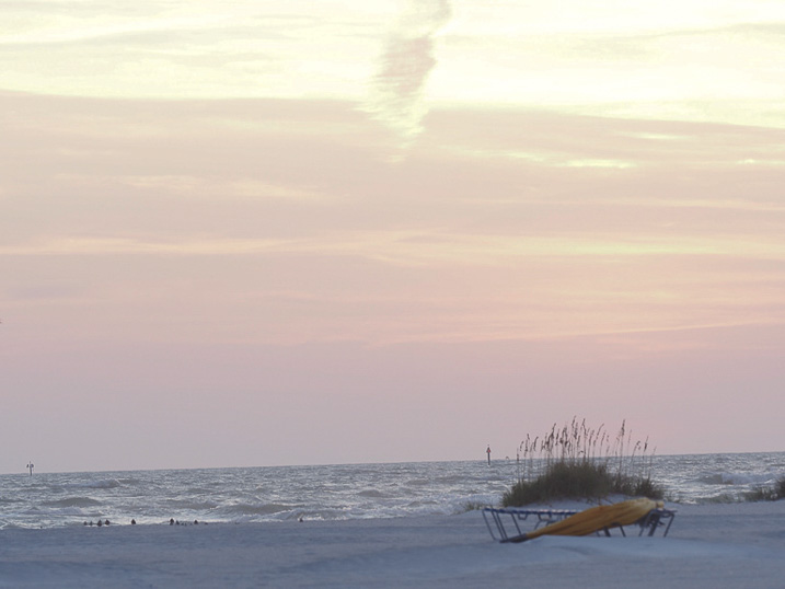 Relax and enjoy the sunset on Treasure Island's beach. Just steps away from the resort.