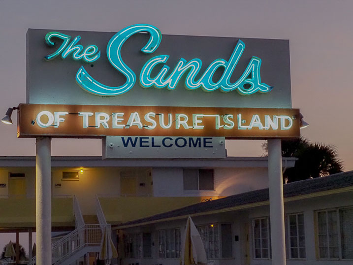 The Sands of Treasure Island welcomes you with its iconic signage at the front entrance on Gulf Boulevard.