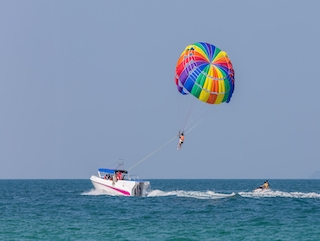 Parasailing is a fun activity to do while visiting The Sands of Treasure Island.